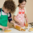 Girl and boy making cakes — Stock Photo