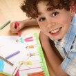 Boy drawing — Stockfoto