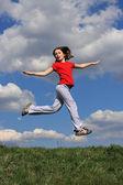 Girl running on green meadow — Stock Photo