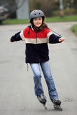 Young girl on rollerblades — Stock Photo