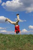 Boy jumping, running against blue sky — Stock Photo