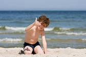 Boy playing on beach — Stock Photo