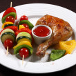 Roasted chicken leg and vegetable kebab — Stock Photo #32720165