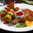 Roasted chicken leg and vegetable kebab — Stock Photo #32720181