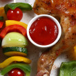 Roasted chicken leg and vegetable kebab — Stock Photo #32720211