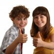 Kids showing thumbs up — Stock Photo