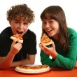 Kids eating pizza — Stock Photo
