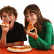 Stock Photo: Kids eating pizza