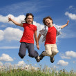 Girl and boy jumping — Stock Photo #32734037