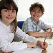 Girl and boy doing homework — Stock Photo