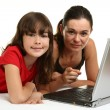 Girls and woman using laptop — Stock Photo #32737573