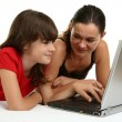 Girls and woman using laptop — Stock Photo