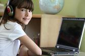 Girl using computer — Stock Photo