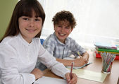 Girl and boy doing homework — Stock Photo