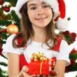 Young girl Santa decorating Christmas tree — Stock Photo #32747755
