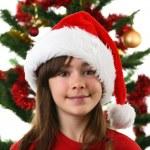 Young girl Santa decorating Christmas tree — Stock Photo #32748155