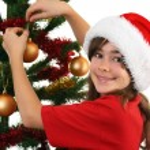 Young girl Santa decorating Christmas tree — Stock Photo #32748541