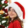 Young girl Santa decorating Christmas tree — Stock Photo