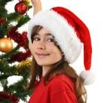 Young girl Santa decorating Christmas tree — Stock Photo #32749063