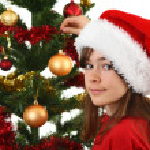 Young girl Santa decorating Christmas tree — Stock Photo #32749465
