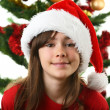 Young girl Santa decorating Christmas tree — Stock Photo #32749491