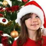 Young girl Santa decorating Christmas tree — Stock Photo #32749549