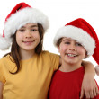 Boy and girl in Santa's hats — Stock Photo