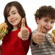 Kids eating healthy sandwiches — Stock Photo