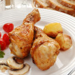 Roasted chicken legs with vegetables — Stock Photo #32759171