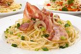 Pasta with bacon and chives — Stock Photo