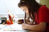 Girl doing homework — Stock Photo