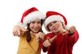 Boy and girl in Santa's hats — Foto Stock