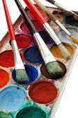 Watercolor set with paintbrushes — Stock Photo