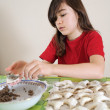Girl preparing food — Stock Photo