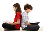 Girl and boy reading books — Stock Photo
