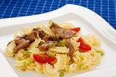 Pasta with roasted meat and vegetables — Stock Photo