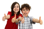 Girl and boy with thumbs up — Stock Photo