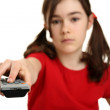 Girl using remote control — Stock Photo