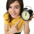 Girl holding alarm-clock — Stock Photo