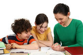 Mother helping her kids to do homework — Foto Stock