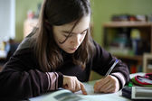 Girl learning at home — Stock Photo
