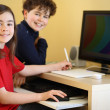Kids using computer at home — Photo