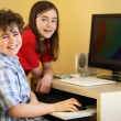 Kids using computer at home — Foto de Stock