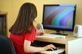 Girl using computer — ストック写真