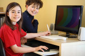 Kids using computer at home — Stock Photo