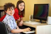 Kids using computer at home — ストック写真