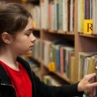 Stock Photo: Young girl in library