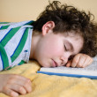 Boy sleeping on book — Stock Photo