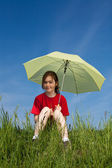 Girl sitting with umbrella — Stock Photo