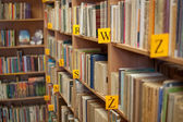 Shelves of books in library — Стоковое фото